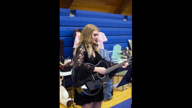 Photo by Barb Hockenbary. Local Jones County Senior and talent Molly Dowling provided musical entertainment during the event.