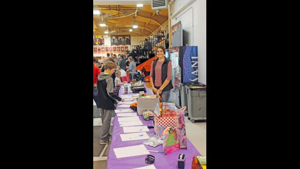 Many businesses were contacted by Sage Gabriel for donating items as a silent auction fundraiser held in the commons area during a Philip doubleheader basketball night.