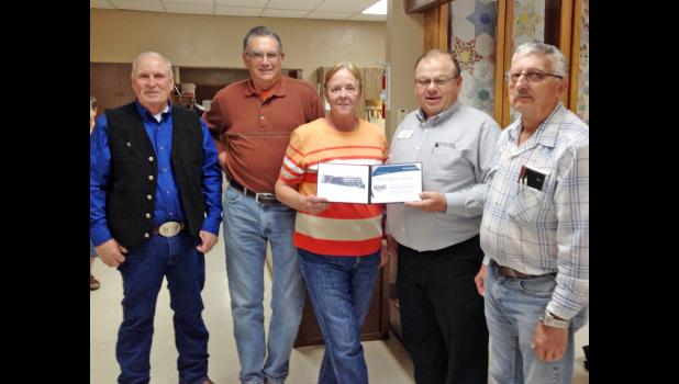 Local Modern Woodmen volunteer leader Don Haynes presented a Hometown Hero certificate and a $100 award grant to the Bad River Senior Citizen's Center in Philip. Shown from left are Marion Matt, Bill and Penny Stahl, Haynes and Phil Pearson.