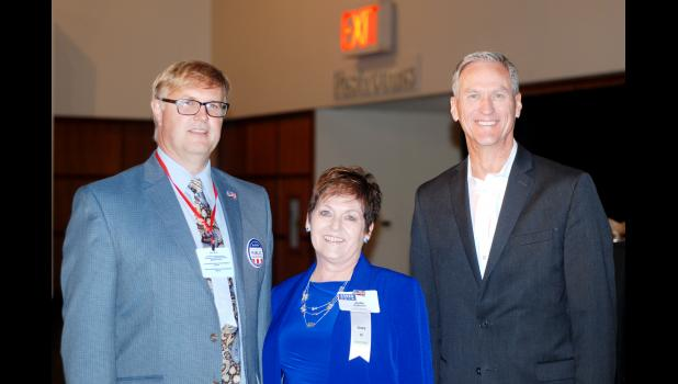 Shown at the Associated School Boards of South Dakota conference are, from left, Eric Stroeder, ASBSD past president, Anita Peterson, new ASBSD president, and Dennis Daugaard, South Dakota governor.