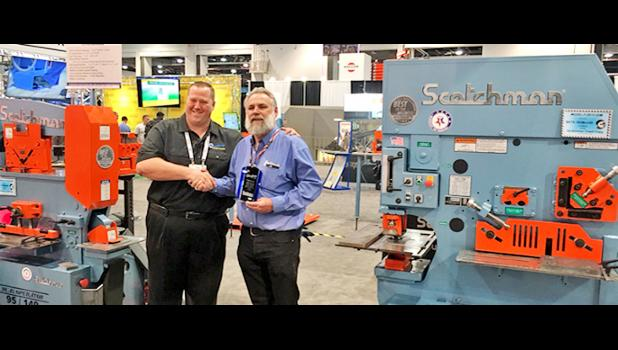 Adam Mattes, the owner of Sterling Machinery, left, presented the company's Top Quality Award to Scotchman Industry, Inc., Philip. Accepting the prestigious recognition was Jerry Kroetch, president of Scotchman.