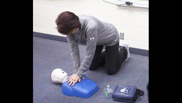 Vanessa Hight shown completing the AED - CPR skill station on test day. CPR was one of many skills taught through the EMT class.