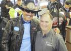 The annual Kyle Petty Charity Ride Across America fundraiser for the children's Victory Junction camp stopped in Wall this year. Wall Mayor Marty Huether, right, presented a $1,000 community check to the cause. Shown is Richard Petty acknowledging the donation.